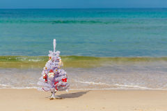 New Year decorated tree on a beach Royalty Free Stock Photo