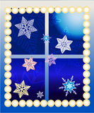 New Year decorated window. Window decorated for Christmas and New Year with garland and snowflakes Royalty Free Stock Images