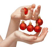 New year decoration 02. Red new year balls in hands Royalty Free Stock Image