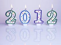 New year decoration 2012. Decorative candles burning, symbolising new year 2012 Royalty Free Stock Images
