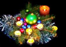 New Year decoration. Balls, tinsel, candel .On black background Stock Image