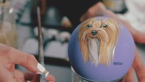 New Year decoration ball. Female paint on new year ball.Hand painted New Year ball,portrait of the dog on the ball.