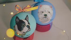 New Year decoration ball. Female paint on new year ball.Hand painted New Year ball,portrait of the dog on the ball,slow