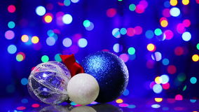 New Year decoration ball toys rotating. On blinking bokeh background stock footage