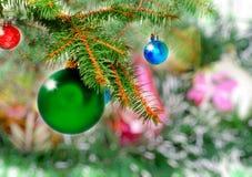 New Year decoration-balls, green tinsel Royalty Free Stock Image