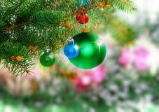 New Year decoration-balls, green tinsel Royalty Free Stock Photos