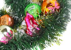 New Year decoration-balls, green tinsel Royalty Free Stock Images