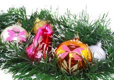 New Year decoration-balls, green tinsel Stock Photos