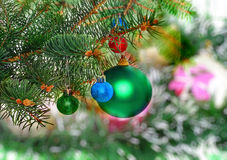 New Year decoration-balls, green tinsel Royalty Free Stock Photo
