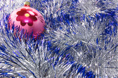 New Year decoration. Christmas decorations are surrounded by shiny tinsel Royalty Free Stock Images