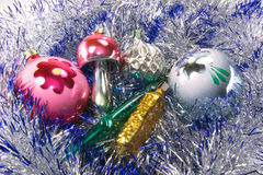 New Year decoration. Christmas decorations are surrounded by shiny tinsel Stock Photo