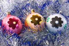 New Year decoration. Christmas decorations are surrounded by shiny tinsel Royalty Free Stock Photo
