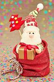 New Year 2015 decoration. Cute Santa Claus in sack  Royalty Free Stock Image