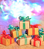 New Year 2015 decoration. Handmade presents with christmas light. New Year 2015 decoration.Handmade gift boxes with ribbons and colorful christmas light Stock Image
