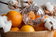 New Year decoration: orange mandarins, Christmas tree toy and cotton. Beautiful and fresh New Year decoration with three parts: orange mandarins, Christmas tree stock image