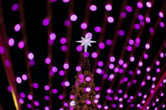 New year decoration with pink bokeh background. Royalty Free Stock Image