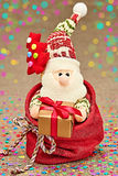 New Year 2015 decoration. Santa Claus in sack of presents Stock Photography