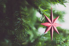 New Year decoration. Star decoration on Christmas tree royalty free stock photography