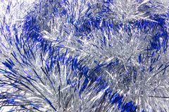 New Year decoration. The texture on the entire frame of the Christmas tinsel blue Stock Images