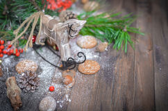 New Year Decoration with Vintage Wooden Horse. Christmas and New Year Decoration with Vintage Wooden Horse, Pine Branches, Oatmeal Cookies, Rowan, Walnuts, Fir Royalty Free Stock Photography