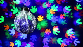 New Year decorations ball on blinking multicolor background stock video