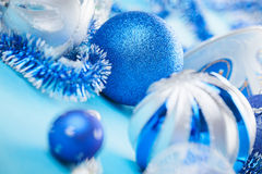 New Year decorations ball on blue Royalty Free Stock Photos