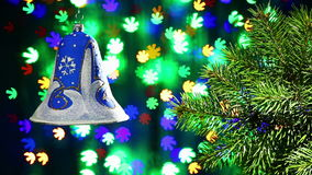 New Year decorations bell on blinking background Stock Images