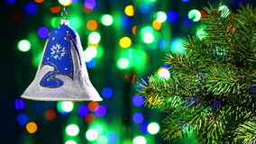 New Year decorations bell on blinking bokeh background. New Year decorations bell on blinking multicolor circles bokeh background stock video footage