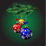 New Year decorations .Bolls on the branch of Christmas  tree. New Year decorations . three colorful Bolls Royalty Free Stock Photos