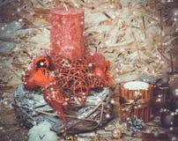New year decorations. Candlestick, cinnamon, snow Stock Photo