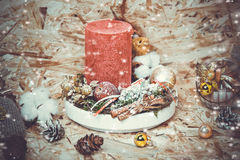 New year decorations. Candlestick, cinnamon, snow Stock Photography