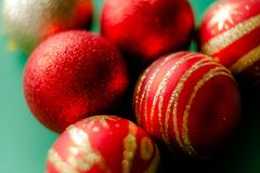 New Year Decorations Christmas balls. Red and golden on green baclground stock images