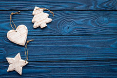 New Year decorations with christmas toys tree, heart and star on blue wooden background top veiw mock up Stock Photography