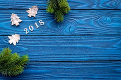 New Year 2018 decorations with christmas tree branche on blue wooden background top veiw mock up Royalty Free Stock Photography