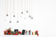 New Year decorations with frosted red berries, candles and silver balls. Winter holidays theme. Free space for text. New Year decorations with frosted red Stock Photos