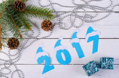 New Year decorations and the inscription in 2017 on a wooden bac. Kground. Christmas wooden background for your text Royalty Free Stock Photography