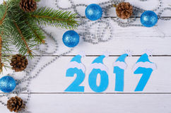 New Year decorations and the inscription in 2017 on a wooden bac Stock Image