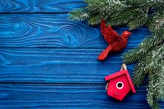 New Year decorations with toys and christmas tree branche on blue wooden background top veiw mock up. New Year decorations with toys and christmas tree branche Royalty Free Stock Photography