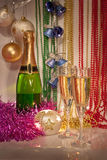 New Year decorations with two glasses and bottle o Stock Photos