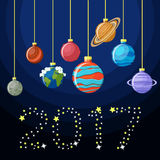 New Year decorative greeting card with Solar system planets as Christmas balls. And the word 2017 made of stars. Happy New year to the Universe concept. Vector Stock Photos