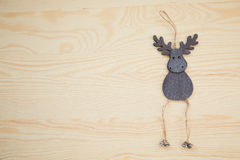 New Year deer on a wooden texture. Handmade deer on a wooden texture Stock Photography