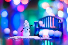 New Year, design photo mysterious bright night snowman bench copy space. Mockup for postcard royalty free stock image
