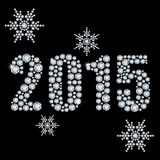 New 2015 year. The new 2015 year diamond on a black background and snowflakes Stock Image
