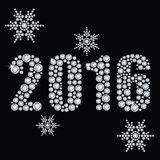New 2016 year. The new 2016 year diamond on a black background and snowflakes Stock Photo