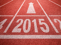 New year 2015 diggits on sport track with arrow Stock Images