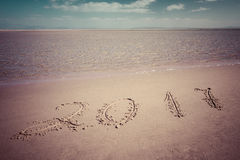 New year 2017 digits. On ocean beach sand Royalty Free Stock Images