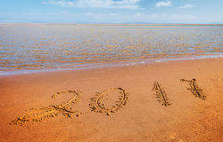 New year 2017 digits. On ocean beach sand Stock Photography