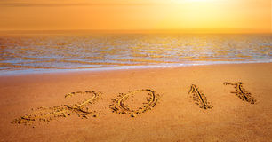 New year 2017 digits. On ocean beach sand Stock Images