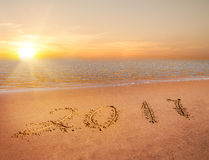 New year 2017 digits. On ocean beach sand Royalty Free Stock Image
