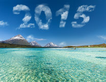 New year 2015 digits. On sky over ocean stock photos